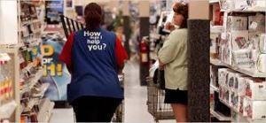 Walmart employee working at store (Photo/William Thomas Cain - Getty Images)