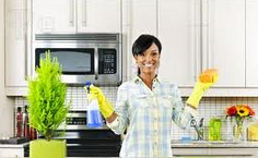 Black woman standing in clean kitchen (Image: Feature Pics)